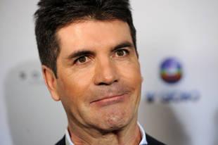 Simon Cowell Loses Bet, Owes L.A. Reid $20,000