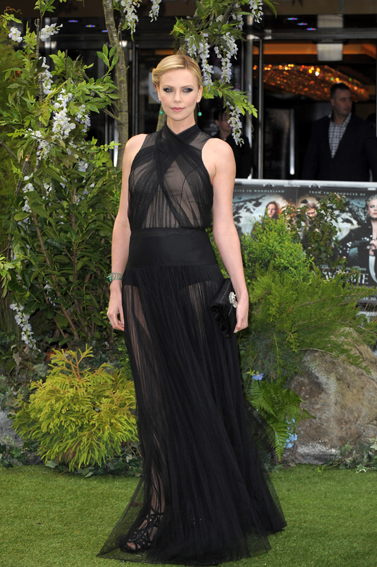 Say WHAT?! Charlize Theron Didn't Have Teeth Until She Was 11