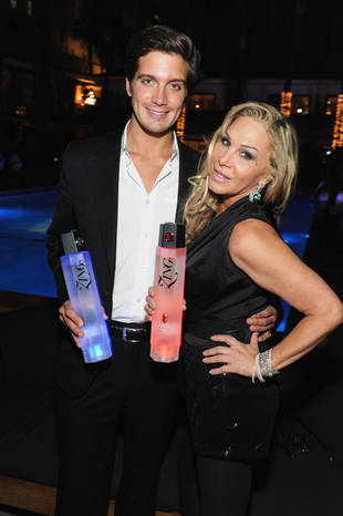 "Adrienne Maloof, Jacob Busch ""All Over Each Other"" At Star Magazine Event"