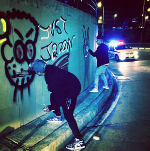 Justin Bieber Posts Photos of Himself Tagging — Was It Legal?
