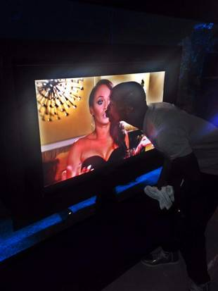 "Chad ""Ochocinco"" Johnson Kisses Evelyn Lozada! On His TV Screen, That Is …  (PHOTO)"