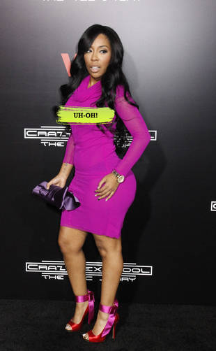 K. Michelle Suffers Wardrobe Malfunction in Magenta See-Through Dress (PHOTO)