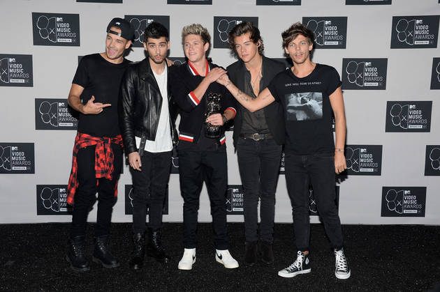 "One Direction Member's Fiancée Slams 1D Fans As ""Probably Overweight"""