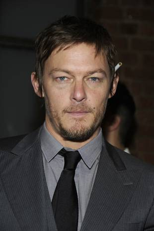 Norman Reedus Gets Crossbow Training in Hilarious Clip From Conan (VIDEO)