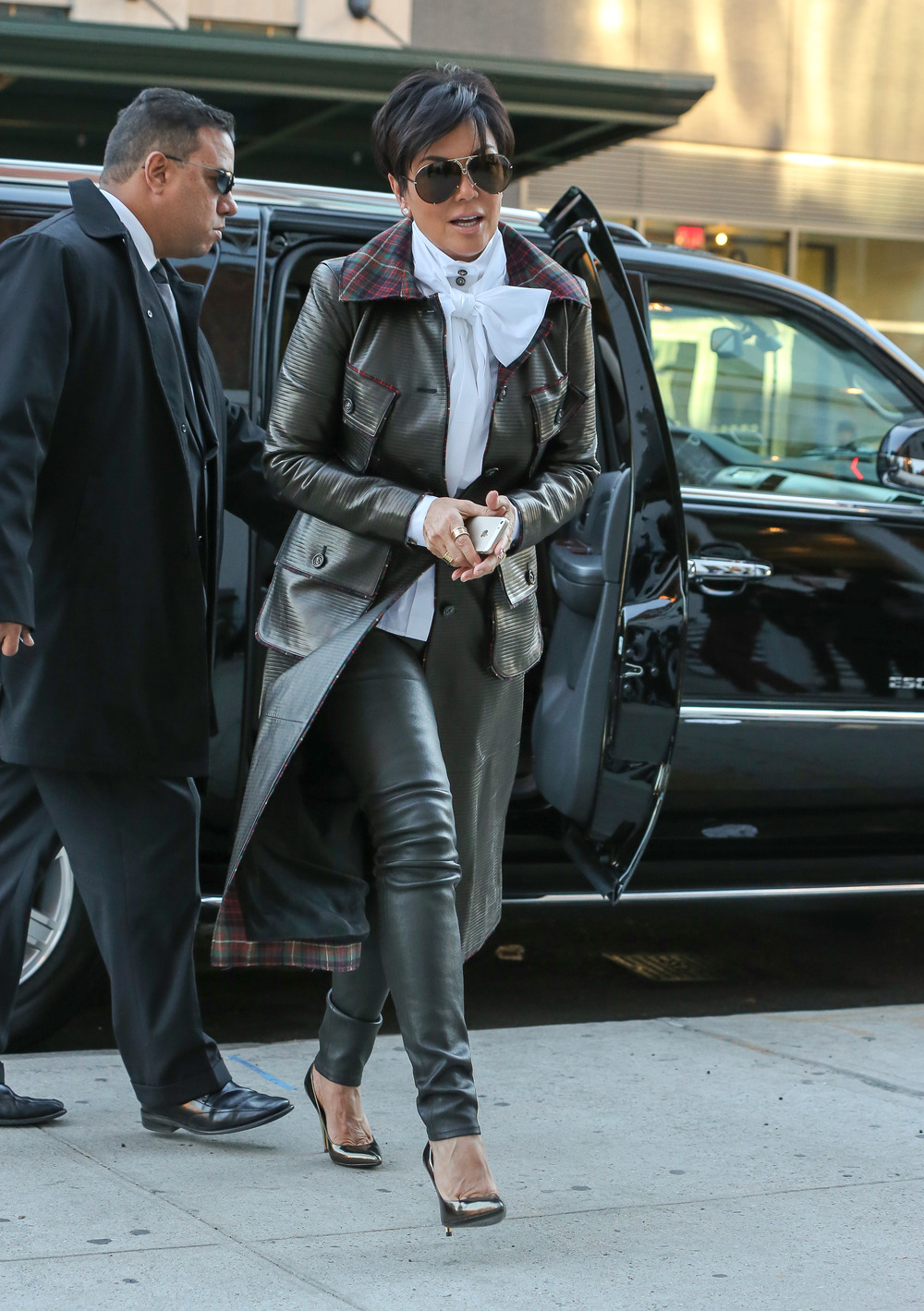 Celebrity wearing trench coat