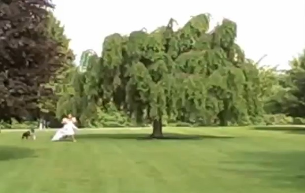 Watch As This Bride Is Hilariously Chased and Tackled By the Family Dog (VIDEO)