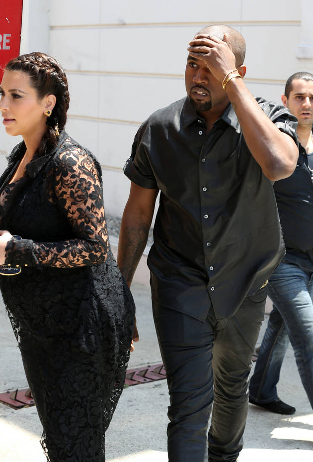 Kanye West Suffers Head Injury On Walk With Kim Kardashian!