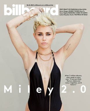 "Miley Cyrus Shows Off Bod in Plunging Swimsuit, Denies Being ""White Nicki Minaj"" (PHOTO)"