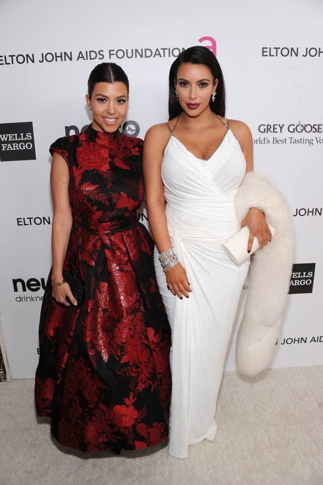 "Kourtney Kardashian Is ""Disgusted"" With Kim's Parenting — Report"