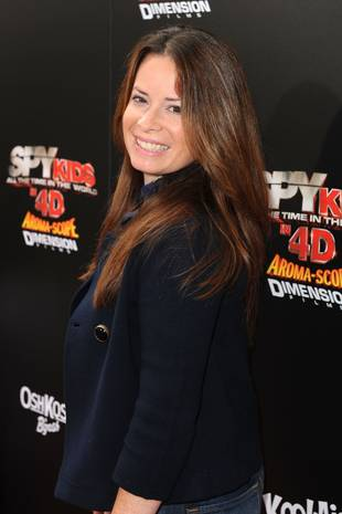 Pretty Little Liars Star Holly Marie Combs Dishes on Her Workout Routine