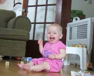 Baby Laughs So Hard at Juggling Dad That She Tips Over (VIDEO)