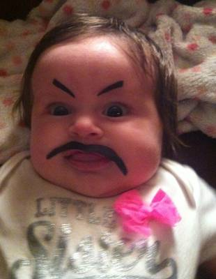 While Mom's Away, Dad Turns Baby Into Supervillain! (PHOTO)