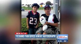 9-Year-Old Gives Away Autographed Football To A Boy In A Wheelchair (VIDEO)