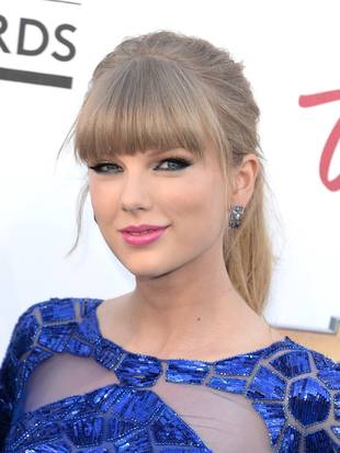 Taylor Swift Surprises Girl Who Was Hit By a Car Outside Her Concert