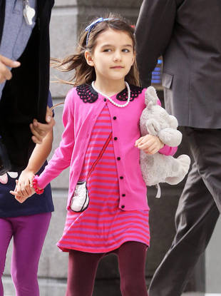 "Suri Cruise's Arm Cast Features ""No Butt Smacking"" Message"