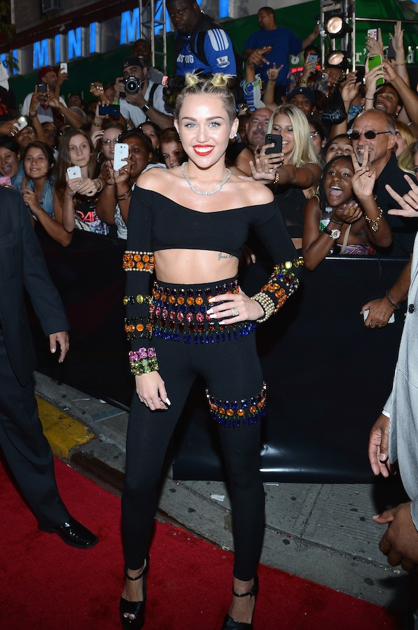 Miley Cyrus Takes Scandalous Photo of Naked Breasts (PHOTO)