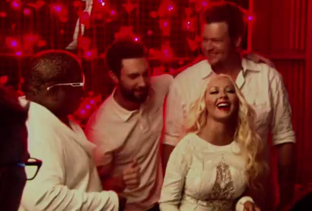 Christina Aguilera Spanks Adam Levine With Her Fan in New Voice 2013 Promo (VIDEO)