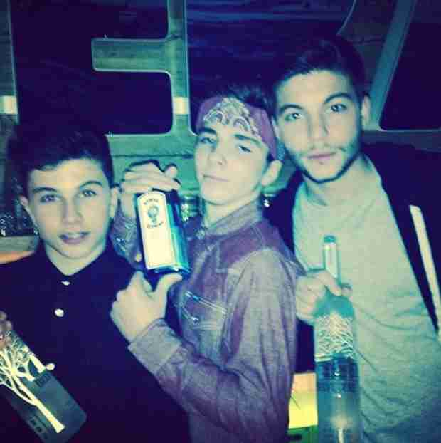 Madonna Photographs 13-Year-Old Son Rocco Holding a Liquor Bottle (PHOTO)