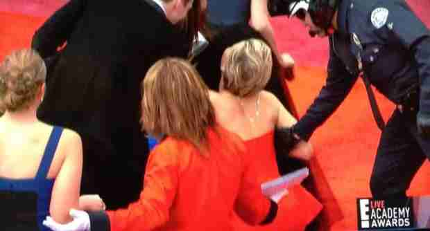 Oscars 2014: Jennifer Lawrence Trips at the Oscars — Again! (VIDEO)