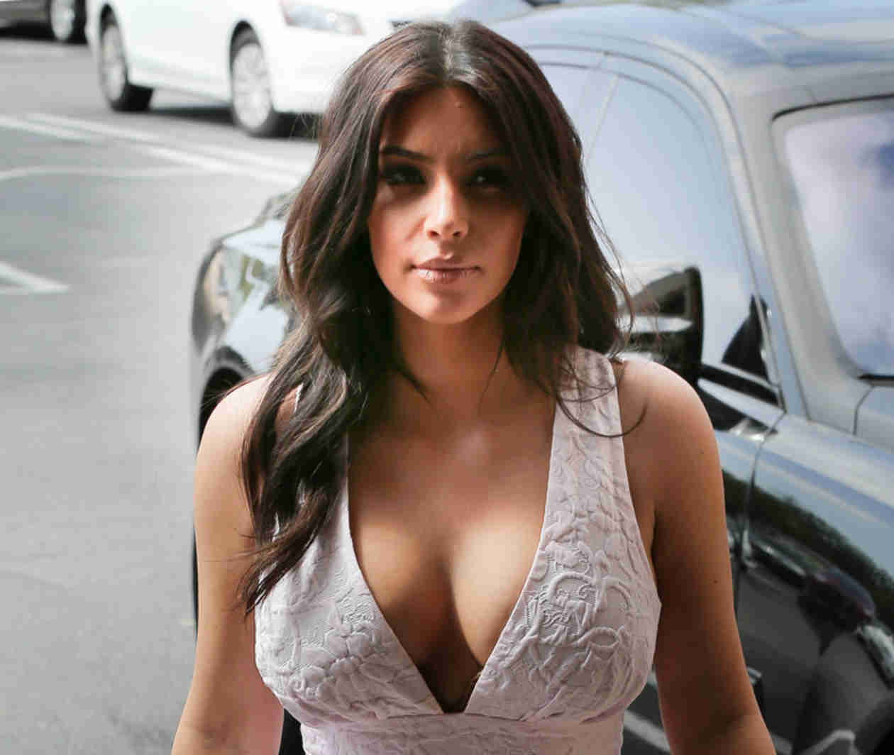 Kim Kardashian Flaunts Crazy Cleavage, Lots of Leg in a Thigh-High Slit Dress