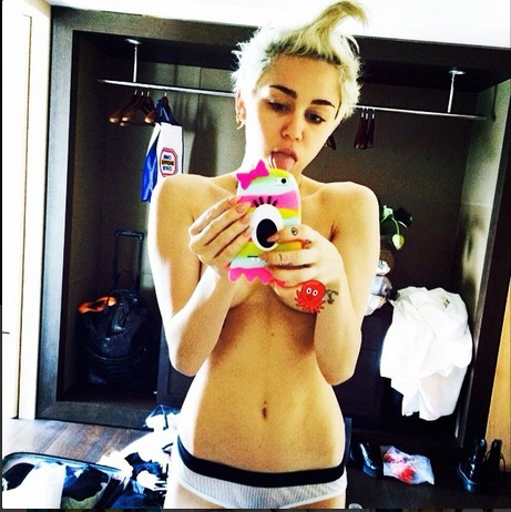 """Miley Cyrus Calls Herself a """"Whore"""" on Instagram — and Goes Topless (PHOTOS)"""
