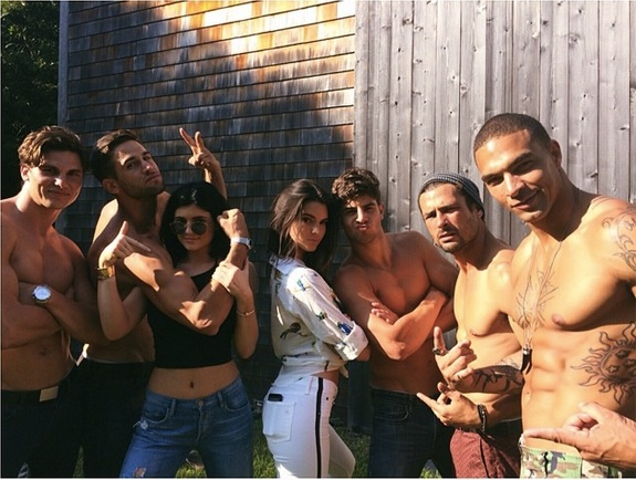 Kendall and Kylie Jenner Pose With Shirtless Male Models (VIDEO)