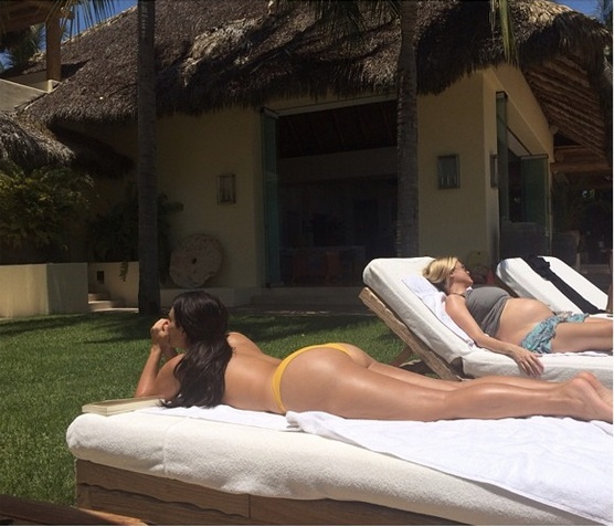 Kim Kardashian Shows Off Her Booty in Topless Poolside Pic