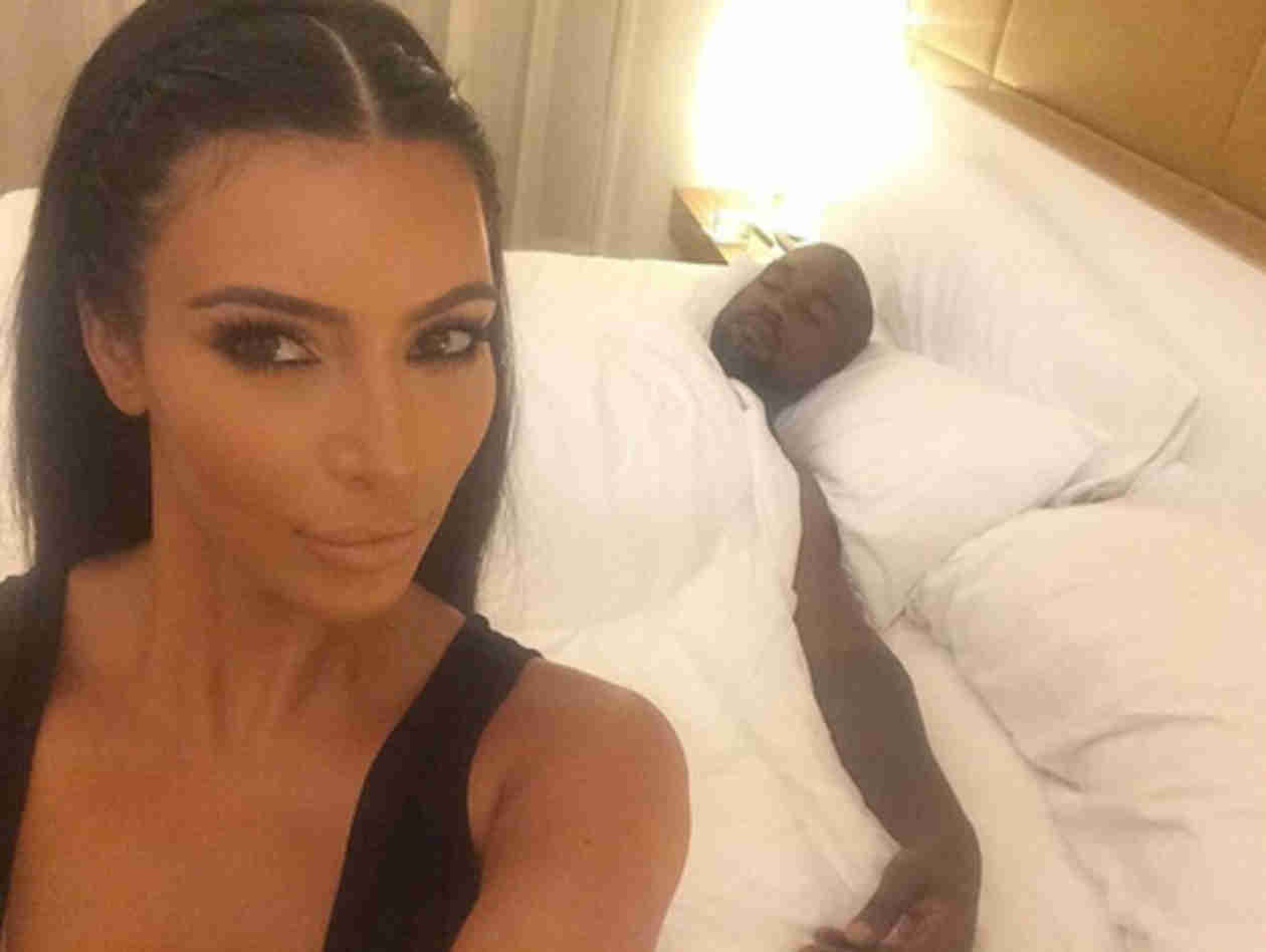 "Kim Kardashian Jokes About Kanye West's ""Side Chicks"" in New Bed Photo (UPDATE)"