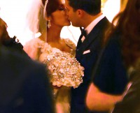 Nicole 'Snooki' Polizzi and Jionni LaValle kiss at the altar as they get married at Lima Church in East Hanover, NJ