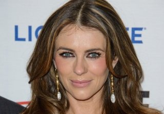 Elizabeth Hurley Hangs Upside-Down From a Stripper Pole (VIDEO)