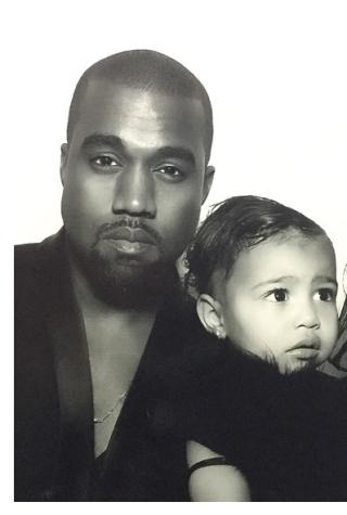 w630_Kanye-West-North-and-Kim-Kardashian-in-2014-Christmas-Photobooth-Shot-1419780225