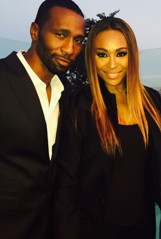 Leon Robinson, Cynthia Bailey, and Peter Thomas at  Debra L. Lee's Pre-BET Awards Dinner on June 24, 2015