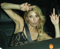 Brandi Glanville throws up hand gestures and almost takes a spill