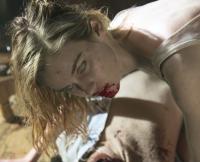 A Walker Feasts on Someone's Face in Season 1, Episode 1 of Fear the Walking Dead