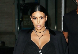 Kim Kardashian Kontinues Krazy Maternity Wear Tour at Givenchy Show (PHOTOS)