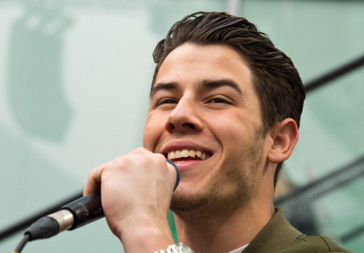 celebrities with extra body parts nick jonas s extra tooth