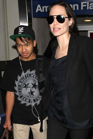 Angelina Jolie and her son Pax were seen arriving at LAX on a flight from New York City.
