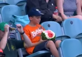The Hero We Deserve: Boy Eats Watermelon Like an Apple