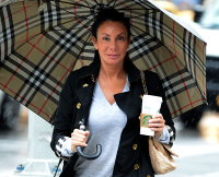 INF - Danielle Staub Steps Out In The Rain