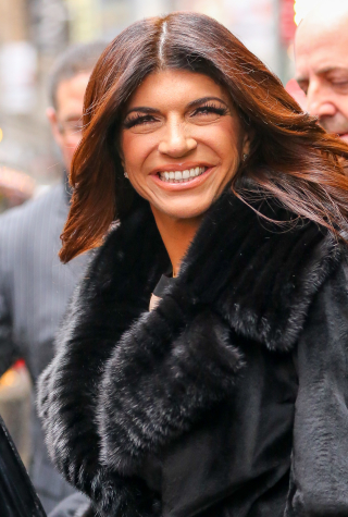 The Real Housewives of New Jersey' Teresa Giudice seen all smiling while promoting her book, as leaving Good Morning America in New York City