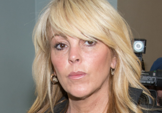 Dina Lohan's Mystery Illness Has Kept Her in the Hospital For a Week