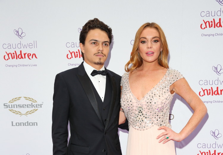 Lindsay Lohan and her fiance Egor Tarabasov arrive at the Caudwell Children Butterfly Ball in London