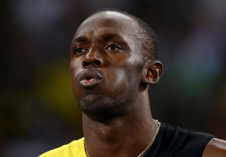 Usain Bolt Caught Kissing Women Who Aren't His Girlfriend (UPDATE)