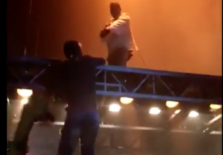 Kanye West Fan Hangs From Stage During His Saint Pablo Tour (VIDEO)